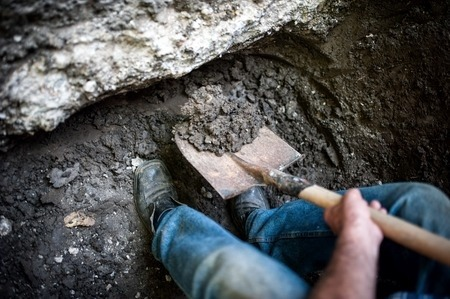 Man Digging a DIY Splash Pad